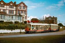 PHOTO  1961 PASSING THE DOUGLAS BAY HOTEL IN 1961 CAR NO 33 WITH TRAILER 61 AND