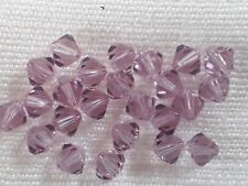 11 genuine Swarovski Crystal 6mm bicone beads light amethyst shade