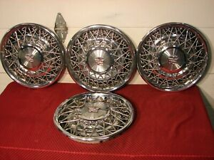 75-85 CADILLAC FLEETWOOD DEVILLE WIRE HUBCAPS.......NICE!!!!