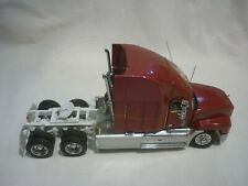 A Franklin mint of a scale model of a 1993 Mack elite CL 613 tractor unit.