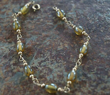 Women's Bracelet brown tinted glass beads with gold tone beads and hardware