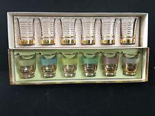 Two sets of retro shot glasses.