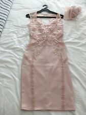 Blush pink ladies embossed dress and fascinator