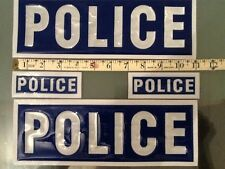 2 Large and 2 small blue police badges  , for film purposes only