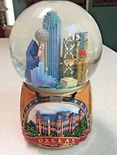 Pre-owned large snow globe showing scene of the city of Dallas, Tx
