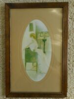 Antique Picture Woman in 1910's on a settee wood framed glass Oval inset faded