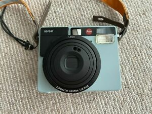 Leica Sofort Mint Polaroid camera with protective case and strap