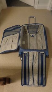 Samsonite soft shell 8 wheel expandable suitcase with garmont holder