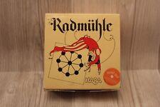 Mini jeu HABA en bois Rodmühle / round morris  - complet