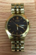 Citizen Eco-Drive E101 Gold Tone Stainless Steel Day Date Men's Watch WR100 READ
