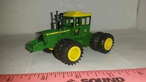 1/64 ERTL custom John deere 7020 4wd tractor w/ Duals and rock box farm toy nice