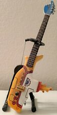 Mini Bass Guitar Beatles Yellow Submarine Memorabilia with stand and box