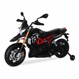 Aprilia noire Dorsoduro 900. moto électrique pour enfants 12V 4.5Ah. 1 place
