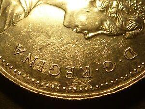 Error - Canada 1983 BU nickel dollar, struck through oil/water, 10% of obverse
