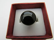 A DARK BROWN AGATE ADJUSTABLE RING. (15mm)   (6)