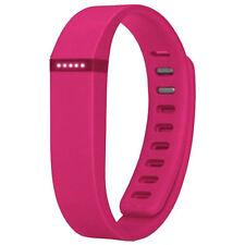 Capteurs d'activité et bracelets roses pour le fitness