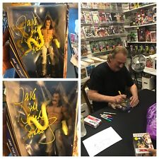 AUTOGRAPHED JAKE THE SNAKE ROBERTS HALL OF FAME SERIES FIGURE (YELLOW)