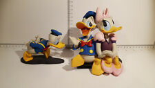 (Lot 523) Walt Disney Collectables - Rare Vintage Donald and Daisy Figures