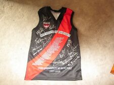 CHAMPIONS OF ESSENDON SIGNED JUMPER IN CHAMPIONS OF ESSENDON TIN