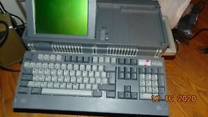 Amstrad PPC 640 portable laptop DOS computer with instruction book and 21 softwa