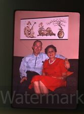 1960s amateur 35mm  Photo slide Man and lady on sofa Asian wall hanging