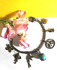 Eye-Catching Antique Style Charm Bracelet - 7 1/2 Inches