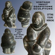 VINTAGE INUIT SOAPSTONE SCULPTURE  MAN WITH ONE HAND IN HIS POUCH & ORIGINAL TAG