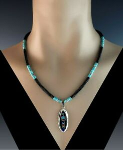 White Fox Creation: Turquoise and Onyx Necklace with Kachina Pendant