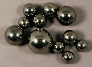 EDGY MIXED SIZES 10-20MM GUNMETAL PLATED SOLID COPPER ROUND BEADS (11 BEADS)