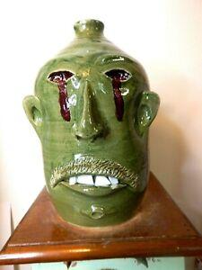 wayne hewell  face jug, pottery, folk art  11''x 7''