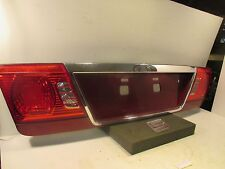 2005 Kia Optima LX Rear Trunk Tail Light License Plate Panel Insert FLAW