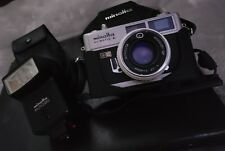 Mint Minolta HI-MATIC E 35mm Camera ROKKOR-QF 40mm f1.7 Lens and Auto 25 Flash