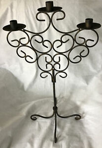"""A LARGE METAL ORNATE 3 ARM CANDELABRA WITH A BLACK AND BRUSHED GOLD FINISH 24"""""""