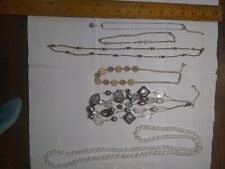 Vintage lot of 6 costume jewelry necklaces. White and silver tones