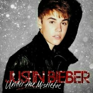 AS NEW ; JUSTIN BIEBER - UNDER THE MISTLETOE CD SET. HIGHLY RECOMMENDED. SUPERB