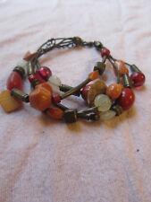 "Bronze Tone Orange & Red Plastic on Elastic Multi Strand Bracelet - 8-10"" long"