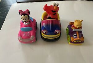 Lot Of Three Children's Toys. Minnie Mouse. Winnie Poo. And Elmo. Preowned Nice