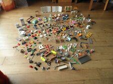 Vrac playmobil dont figurine, accessoires ,pièces diverses