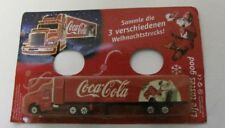 Coca Cola - Santa Claus in chair kicking his boots off/ Mack truck