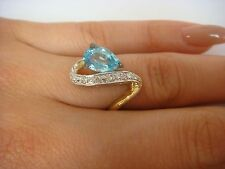 14K YELLOW GOLD BLUE TOPAZ AND DIAMONDS LADIES RING 4.3 GRAMS, SIZE 6