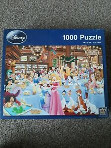 1000 piece jigsaw puzzle used, complete. King- Disney Afternoon Tea Party