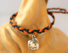 Handmade orange & black braided bracelet with smiling pumpkin charm. Goth Rock