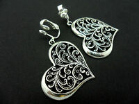 A PAIR OF DANGLY TIBETAN SILVER CHUNKY  HEART CLIP ON  EARRINGS.  NEW.
