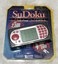 New Excalibur Electronic Sudoku Hand Held Game pkg discoloured  see pictures