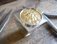 Anello con sigillo piazza in argento massive con cristo d'oro