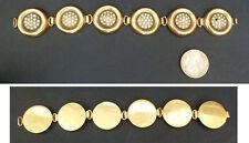 Beau bracelet en métal doré et strass