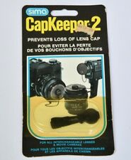 Camera lens cap accessory:  Sima Capkeeper 2