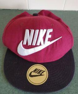 NIKE BASEBALL CAP. BURGUNDY WITH BLACK BRIM
