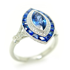 18K White Gold Ring With Diamonds and Marquis Sapphire Centerpiece