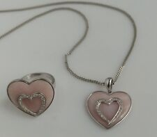 1 9ct white gold Ladies heart shape coral set with a white gold dia embed heart